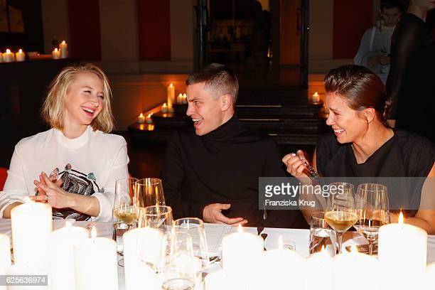 Anna Maria Muehe Jannik Schuemann and Jessica Schwarz attend the mytheresacom JW Anderson dinner at Berliner Lapidarium on November 24 2016 in Berlin...