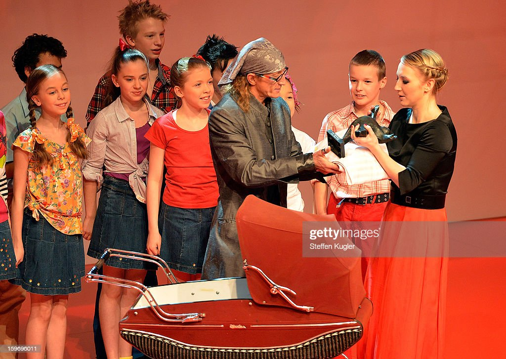 Anna Maria Muehe (R) on stage with puppet comedians 'The Helmi' as she receives her award at the B.Z. Kulturpreis on January 18, 2013 in Berlin, Germany.