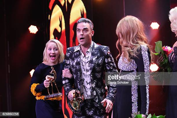 Anna Maria Muehe Robbie Williams with award and Palina Rojinski after the Bambi Awards 2016 show at Stage Theater on November 17 2016 in Berlin...