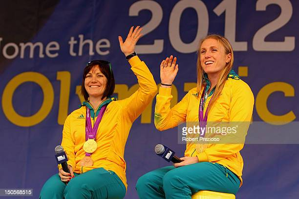 Anna Meares and Sally Pearson speak to fans during the Australian Olympic Team Homecoming Parade at Federation Square on August 22 2012 in Melbourne...