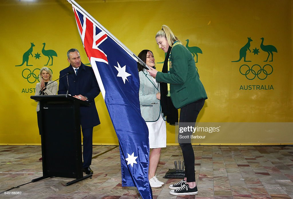 Anna Meares is presented with the Australian flag by Lauren Jackson, flagbearer for the 2012 London Olympic Games during the Australian Olympic Games flag bearer announcement at Federation Square on July 6, 2016 in Melbourne, Australia.