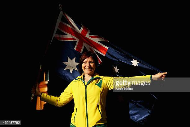 Anna Meares of Australia poses with the Australian flag after she was announced as the flag bearer for the opening ceremony during the Austrlian...