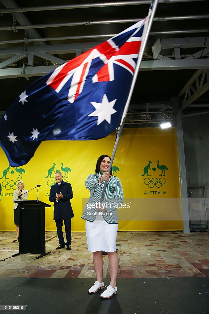 Anna Meares waves the Australian flag during the Australian Olympic Games flag bearer announcement at Federation Square on July 6, 2016 in Melbourne, Australia.