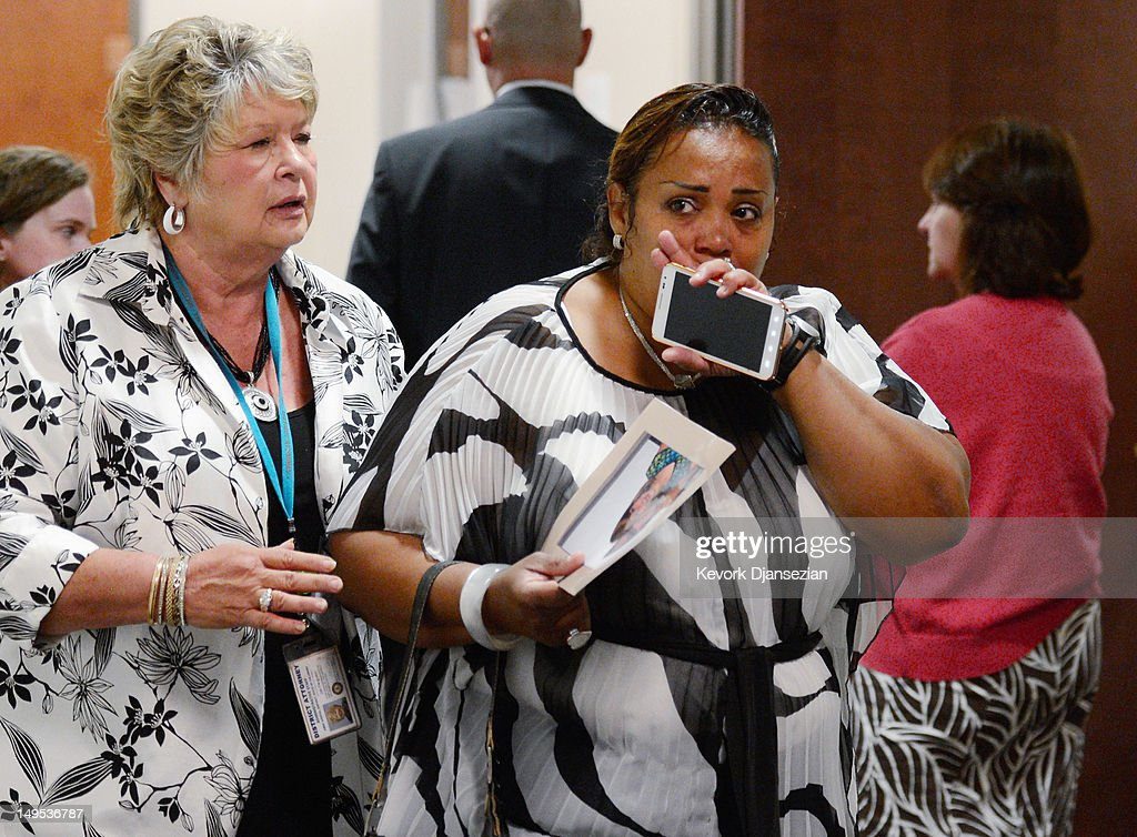 Anna Moser, step-mother Ashley Moser, who is the mother of six-year-old Veronica Moser-Sullivan, the youngest victim of the theater shooting, arrives at the Arapahoe County Courthouse for the arraignment of accused theater gunman James Holmes July 30, 2012 in Centennial, Colorado. Holmes is charged with 24 counts of murder and 116 counts of attempted murder in the July 20, shooting rampage at an opening night screening of 'The Dark Knight Rises' in Aurora, Colorado.