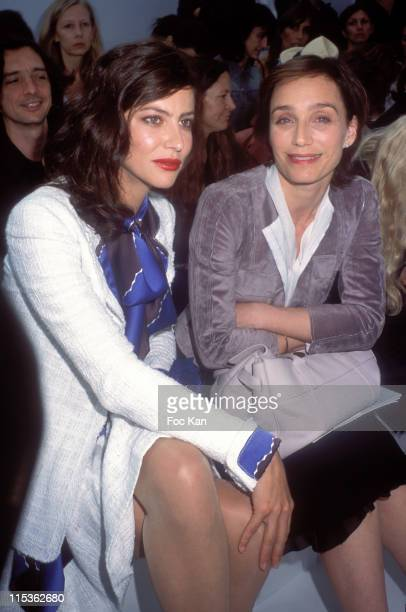 Anna Mouglalis and Kristin Scott Thomas during 2004 Paris Fashion Week Haute Couture Fall/Winter Chanel Front Row at Ateliers Berthier in Paris France