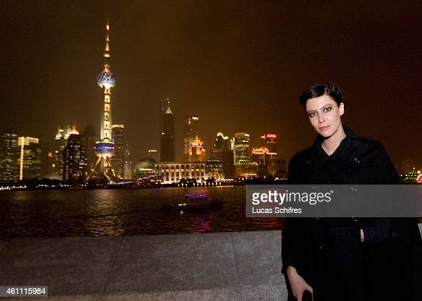 Anna Mouglalis poses for a photograph in front of the Oriental TV Tower and the Pudong skyline considered the symbol of Shanghai at Chanel Fashion...