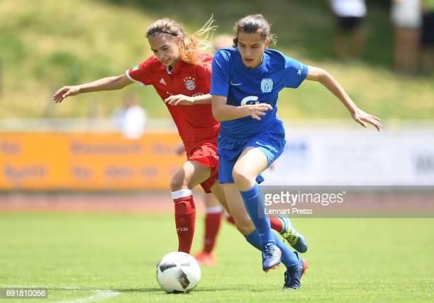 Anna Mueller of FC Bayern Muenchen challenges Jasmin Jabbes of SV Meppen during the B Junior Girl's German Championship Semi Final First Leg match...