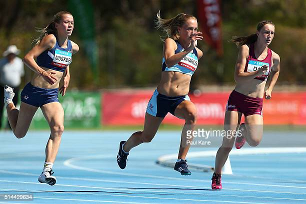 Anna Musker of Victoria Kristie Edwards of New South Wales and Riley Day of Queensland compete in the Women's 200 metre u17 heat during the...
