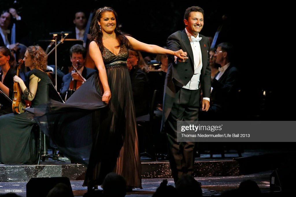<a gi-track='captionPersonalityLinkClicked' href=/galleries/search?phrase=Anna+Netrebko&family=editorial&specificpeople=732328 ng-click='$event.stopPropagation()'>Anna Netrebko</a> and Piotr Beczala perform at the 'Red Ribbon Celebration Concert - United in Difference' at Burgtheater on May 24, 2013 in Vienna, Austria.