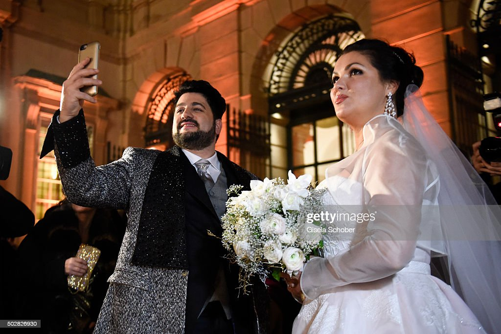 <a gi-track='captionPersonalityLinkClicked' href=/galleries/search?phrase=Anna+Netrebko&family=editorial&specificpeople=732328 ng-click='$event.stopPropagation()'>Anna Netrebko</a> and Yusif Eyvazov watch fireworks during their wedding at Palais Liechtenstein on December 29, 2015 in Vienna, Austria.