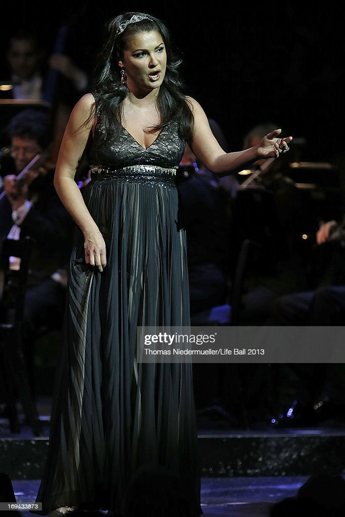 <a gi-track='captionPersonalityLinkClicked' href=/galleries/search?phrase=Anna+Netrebko&family=editorial&specificpeople=732328 ng-click='$event.stopPropagation()'>Anna Netrebko</a> performs at the 'Red Ribbon Celebration Concert - United in Difference' at Burgtheater on May 24, 2013 in Vienna, Austria.