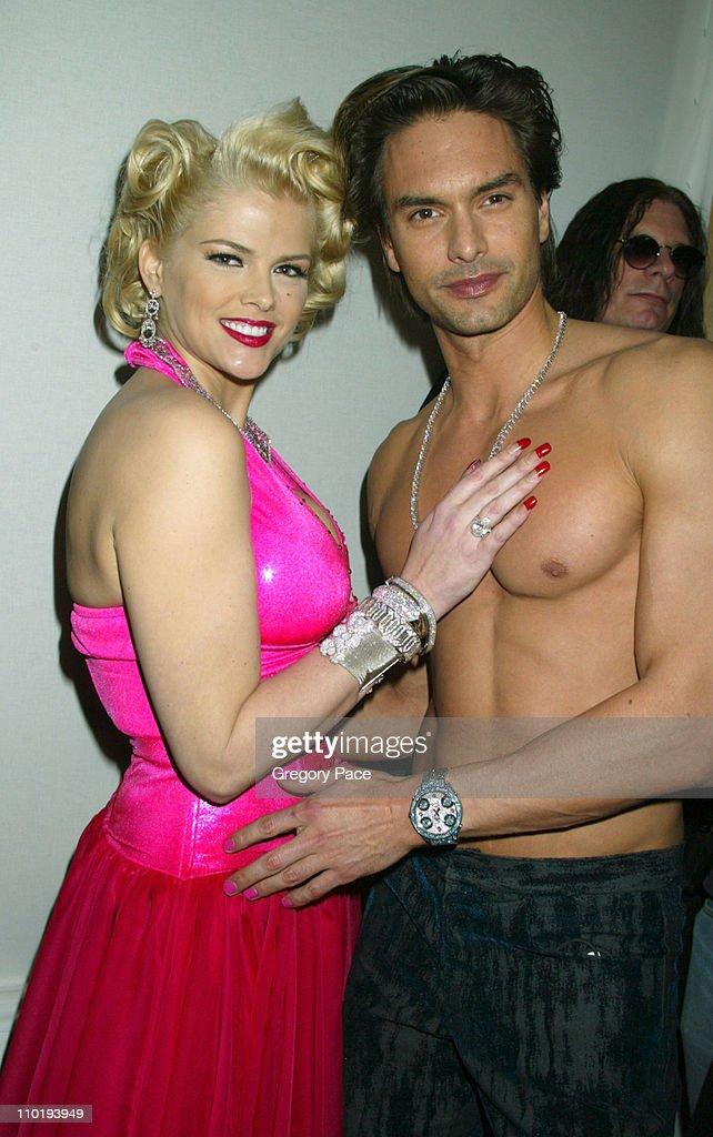 Anna Nicole Smith and Marcus Schenkenberg wearing Heatherette