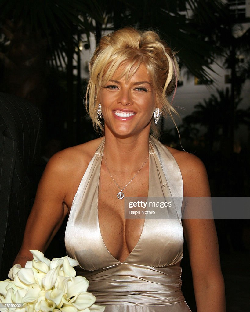 <a gi-track='captionPersonalityLinkClicked' href=/galleries/search?phrase=Anna+Nicole+Smith&family=editorial&specificpeople=156420 ng-click='$event.stopPropagation()'>Anna Nicole Smith</a> attends a wedding as the Maid of Honor for Penny and Joseph Genovese as they renew their wedding vows, poolside at the Seminole Hard Rock Hotel and Casino on July 21, 2005 in Hollywood, Florida.