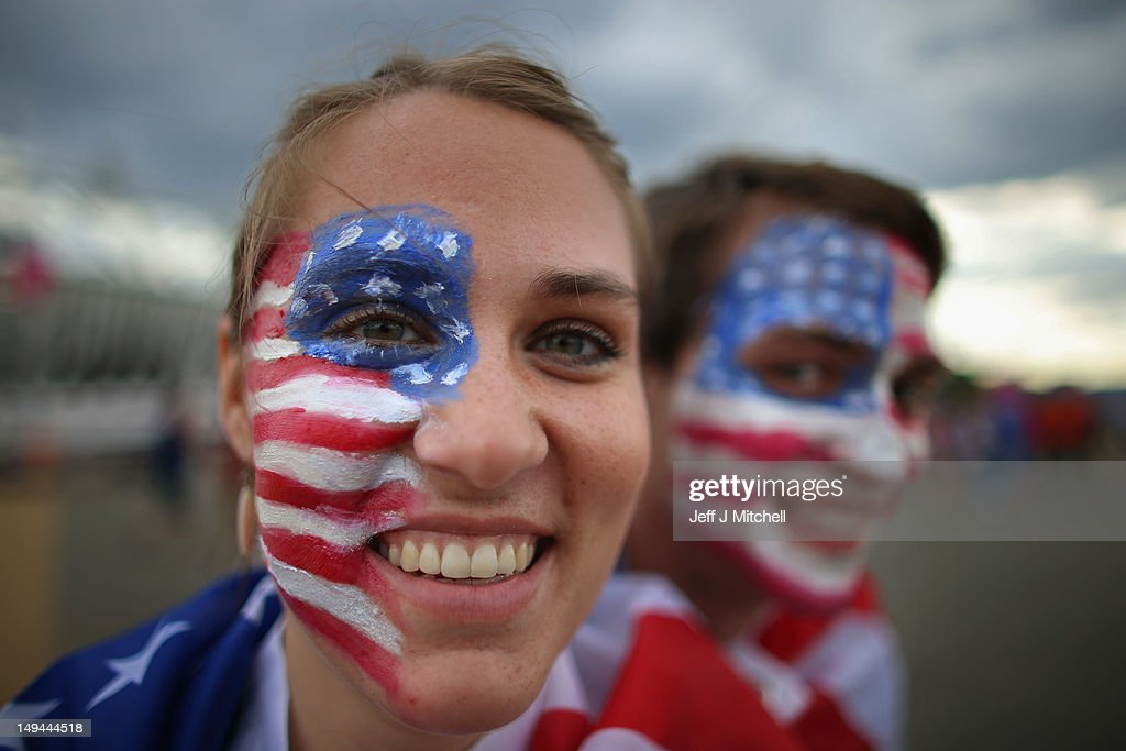Anna Nolte and Matt Allbee pose with their painted faces on day one of the London 2012 Olympic Games at the Olympic Park on July 28, 2012 in London, England.