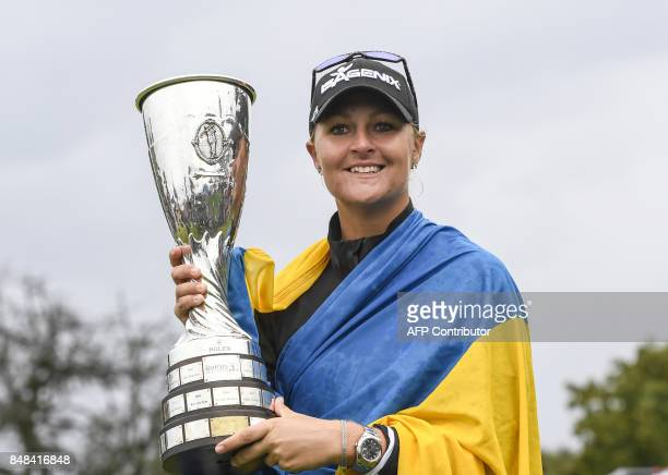 Anna Nordqvist from Sweden holds her trophy after winning the Evian Championship tournament on September 17 2017 in the French Alps town of...