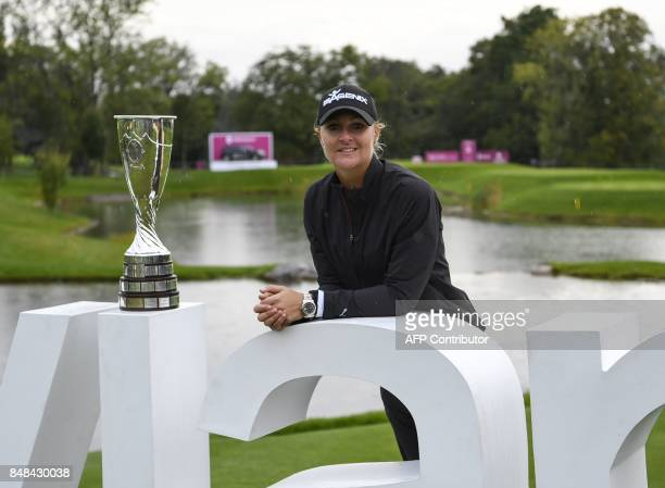 Anna Nordqvist from Sweden poses with her trophy after winning the Evian Championship tournament on September 17 2017 in the French Alps town of...