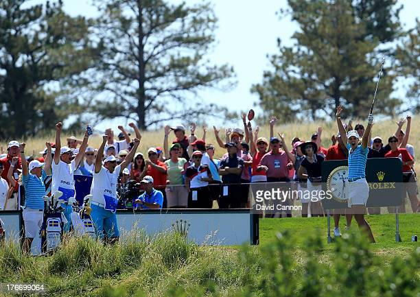 Anna Nordqvist of Sweden and the European Team celebrate her hole in one on the 17th hole as her partner Caroline Hedwall of Sweden and caddies...