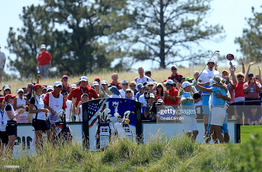 <a gi-track='captionPersonalityLinkClicked' href=/galleries/search?phrase=Anna+Nordqvist&family=editorial&specificpeople=2259645 ng-click='$event.stopPropagation()'>Anna Nordqvist</a> of Sweden and the European Team celebrate her hole in one on the 17th hole as her partner <a gi-track='captionPersonalityLinkClicked' href=/galleries/search?phrase=Caroline+Hedwall&family=editorial&specificpeople=4496797 ng-click='$event.stopPropagation()'>Caroline Hedwall</a> of Sweden and caddies Henrik Hilford Brander (Hedwall) and Jason Gilroyed (Nordqvist) join in the celebrations. Nordqvist and Hedwall won their match against Morgan Pressel and Jessica Korda with this shot during the morning foursomes matches for the 2013 Solheim Cup at The Colorado Golf Club on August 17, 2013 in Parker, Colorado.