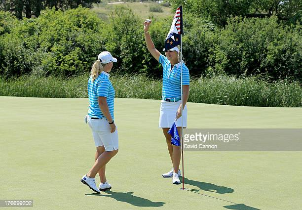 Anna Nordqvist of Sweden and the European Team collects her ball from the hole at the 17th hole which she holed in one which meant that she and her...