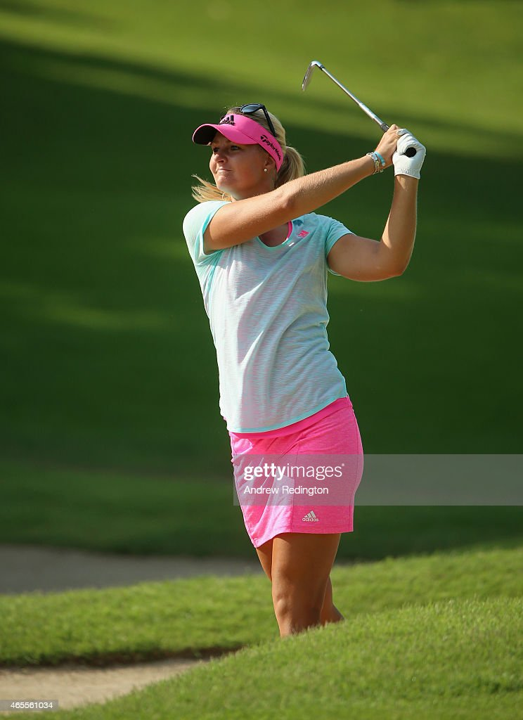 Anna Nordqvist of Sweden hits her approach on the first hole during the final round of the HSBC Women's Champions at Sentosa Golf Club on March 8...