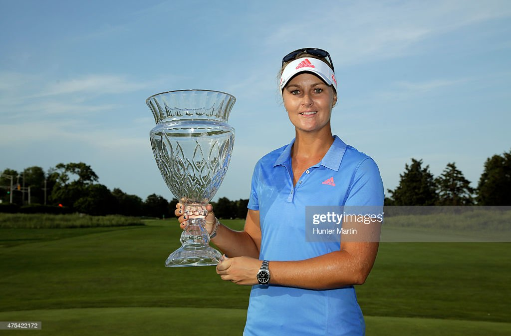 Anna Nordqvist of Sweden holds the championship trophy after winning the ShopRite LPGA Classic presented by Acer on the Bay Course at the Stockton...