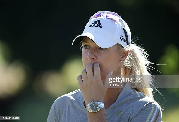Anna Nordqvist of Sweden looks on after being assessed a two stroke penalty for grounding her club in a bunker on the 17th hole and losing a playoff...