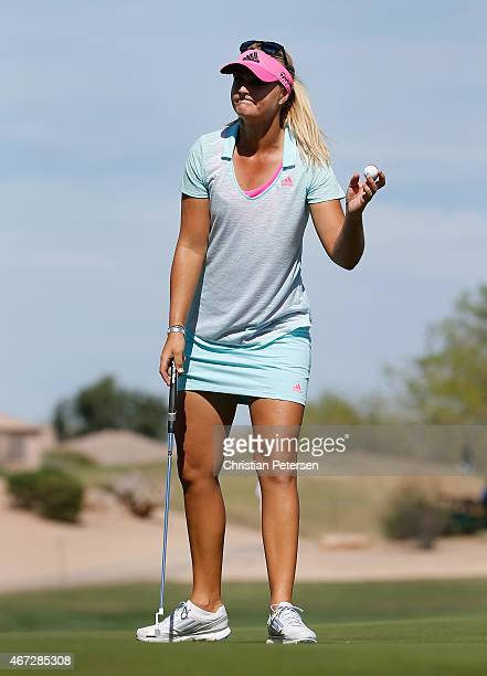 Anna Nordqvist of Sweden reacts to a par putt on the 18th green to complete her final round of the LPGA Founders Cup at Wildfire Golf Club on March...