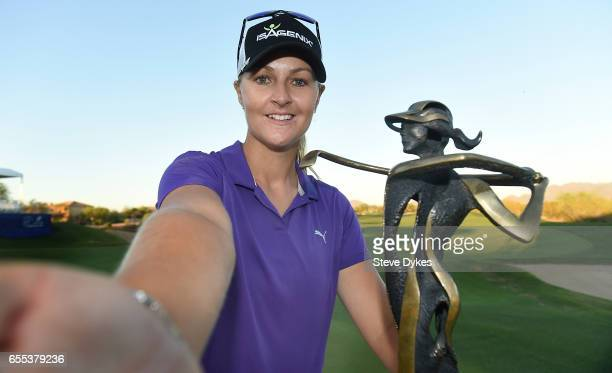 Anna Nordqvist of Sweden takes a selfie with the trophy after winning the Bank Of Hope Founders Cup at Wildfire Golf Club at the JW Marriott Desert...
