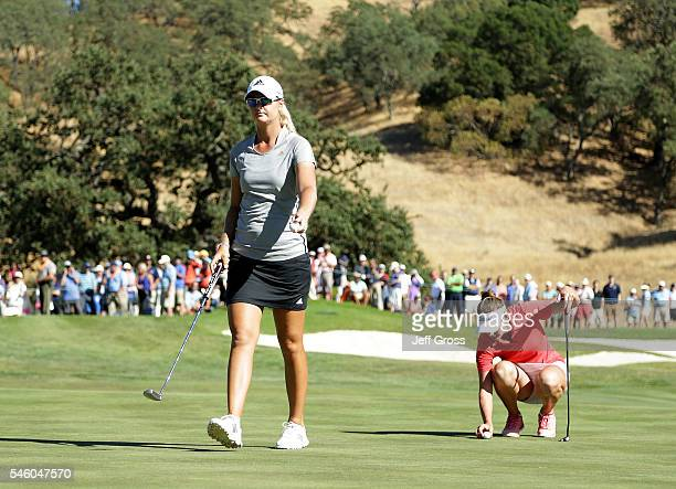 Anna Nordqvist of Sweden walks off the 18th green after she was assessed a two stroke penalty for grounding her club in a bunker on the 17th hole and...