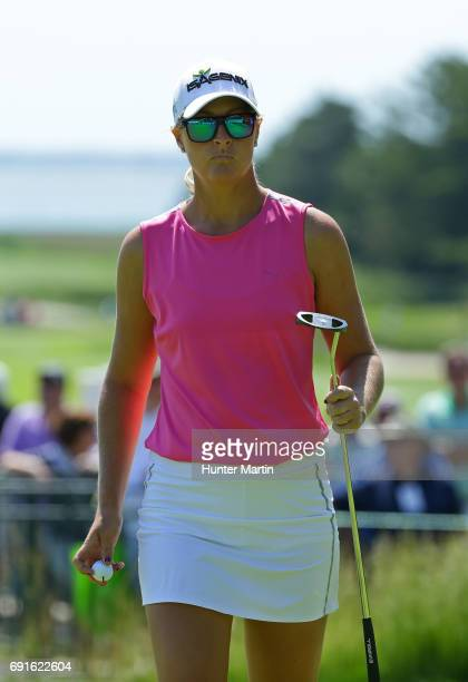 Anna Nordqvist of Sweden walks off the green after making birdie on the 18th hole during the first round of the ShopRite LPGA Classic presented by...