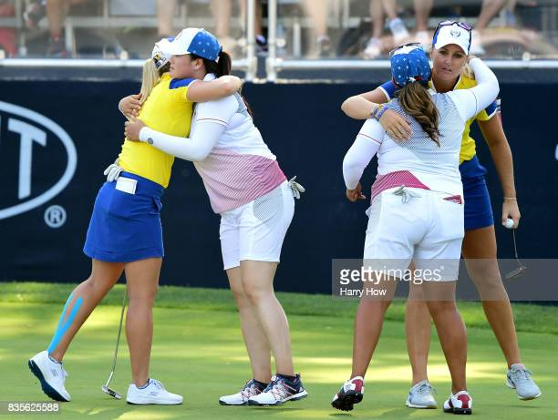Anna Nordqvist of Team Europe receives a hug from Lizette Salas of Team USA while Angel Yin of Team USA hugs Jodi Ewart Shadoff of Team Europe after...