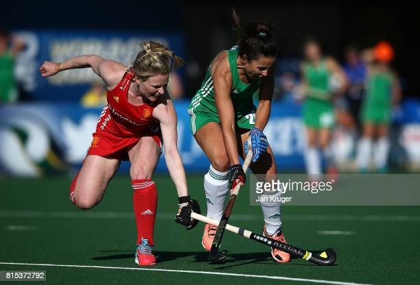 Anna O'Flanagan of Ireland battles with Hollie Webb of England during day 5 of the FIH Hockey World League Women's Semi Finals Pool A match between...