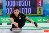 Anna Ohmiya compete during the women's curling round robin game between Japan and Germany on day 10 of the Vancouver 2010 Winter Olympics at...