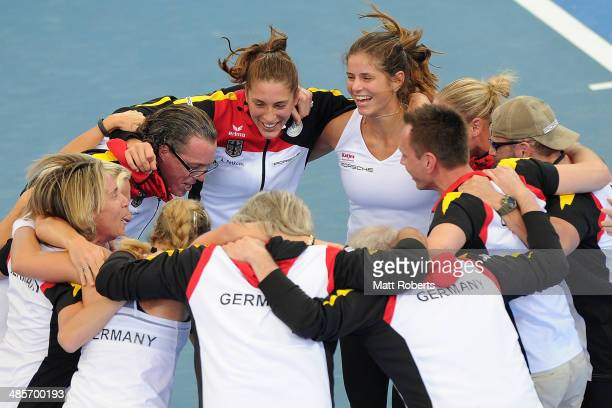 Anna Petkovic and Julia Goerges of Germany celebrate victory with teammates during the Fed Cup Semi Final tie between Australia and Germany at Pat...