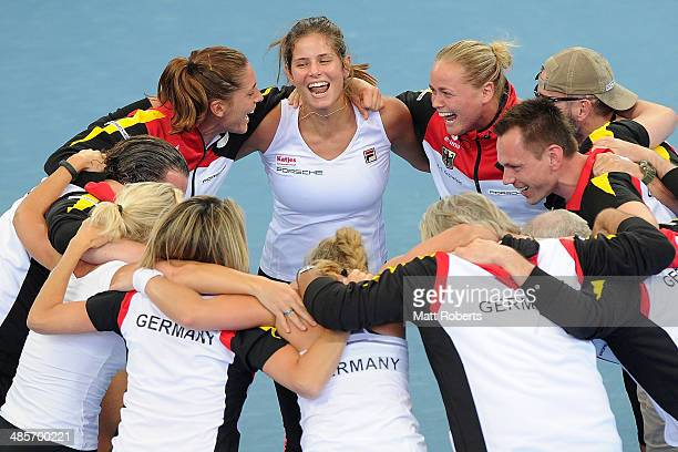 Anna Petkovic Julia Goerges and AnnaLena Groenefeld of Germany celebrate victory with teammates during the Fed Cup Semi Final tie between Australia...