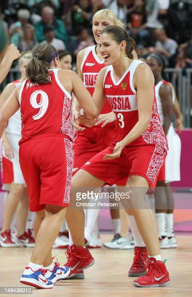 Anna Petrakova of Russia celebrates with Becky Hammon of Russia after defeating Canada 5853 during Women's Basketball on Day 1 of the London 2012...