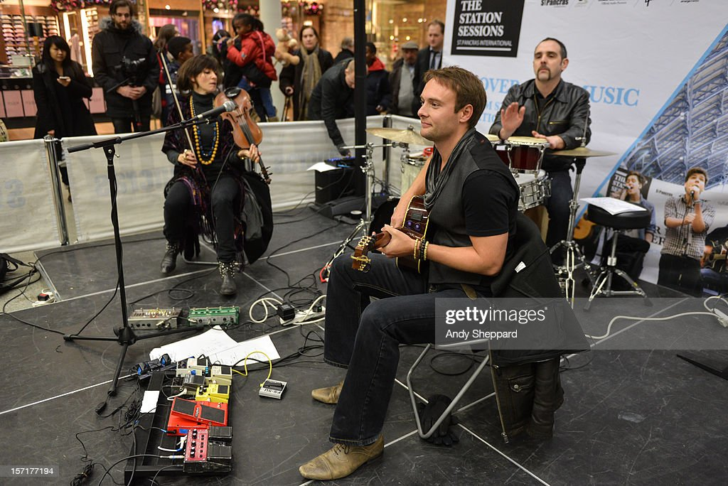 Anna Phoebe (L) and Byron Johnston (C) perform as part of the Station Sessions 2012 at St Pancras Station on November 29, 2012 in London, England.