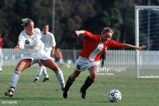 Anna Rask of Christian Brothers University is tripped by Christine Wensel of the University of CaliforniaSan Diego during the Women's Division 2...