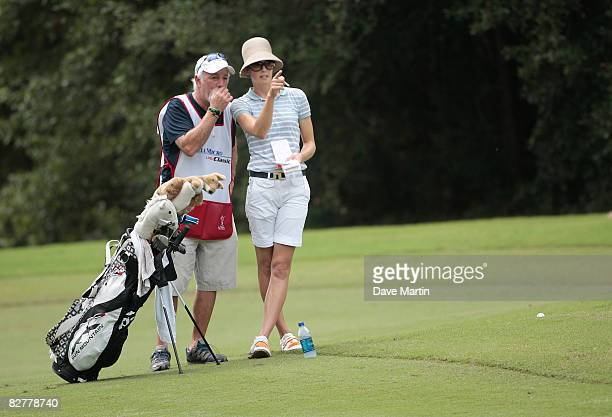 Anna Rawson of Australia talks with her caddie in the 9th fairway during first round play in the Bell Micro LPGA Classic at Magnolia Grove Golf...
