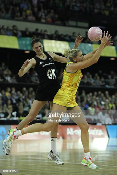 Anna Scarlett of New Zealand and Catherine Cox of Australia compete for the ball during the second Test Match between the Australian Diamonds and the...