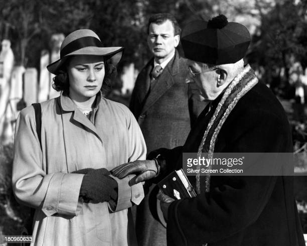 Anna Schmidt played by Alida Valli is comforted by a priest as Holly Martins played by Joseph Cotten looks on in 'The Third Man' directed by Carol...