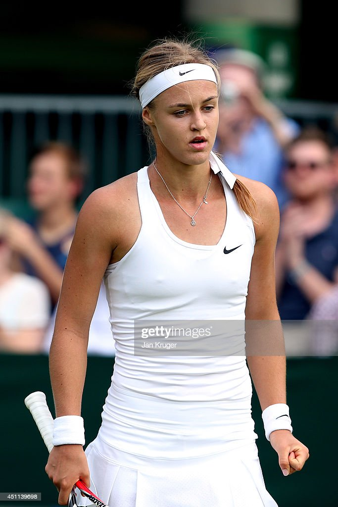 Anna Schmiedlova of Slovakia reacts during her Ladies' Singles first round match against against Alize Cornet of France on day two of the Wimbledon Lawn Tennis Championships at the All England Lawn Tennis and Croquet Club at Wimbledon on June 24, 2014 in London, England.