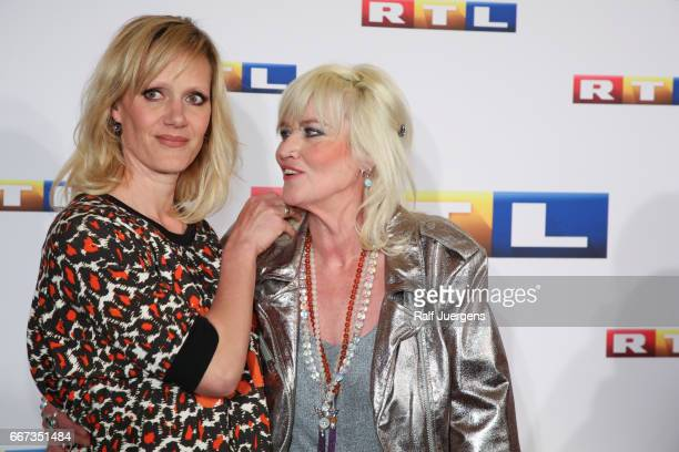 Anna Schudt and Gaby Koester attend the premiere of the film 'Gaby Koester Ein Schnupfen haette auch gereicht' at Residenz Kino on April 11 2017 in...