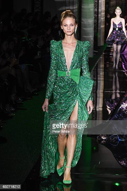 Anna Selezneva walks the runway during the Zuhair Murad Spring Summer 2017 show as part of Paris Fashion Week on January 25 2017 in Paris France
