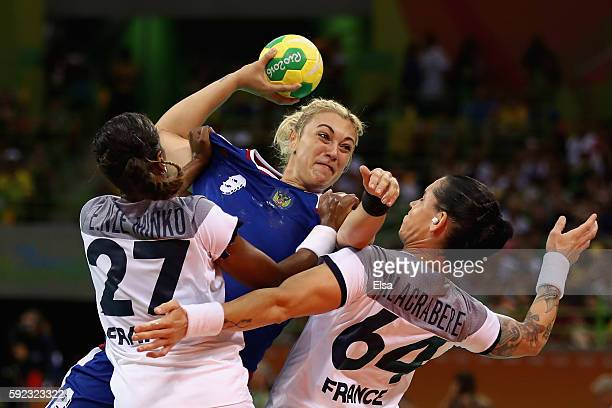 Anna Sen of Russia takes a shot under pressure of Estelle NzeMinko of France and Alexandra Lacrabere of France during the Women's Handball Gold medal...