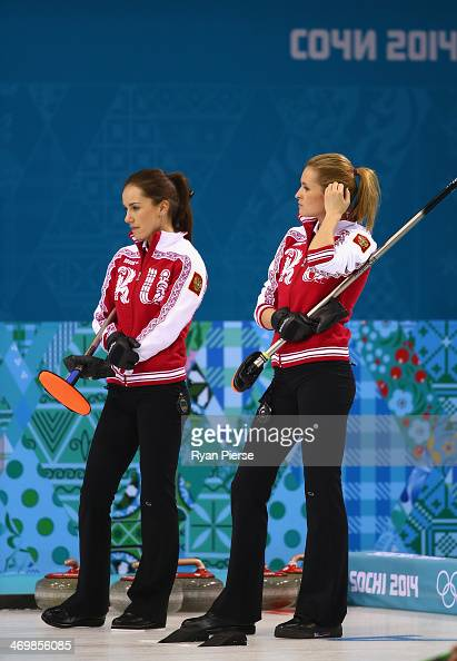 Anna Sidorova and Alexandra Saitova of Russia compete during the Curling Women's Round Robin match between Russia and Great Britain on day ten of the...