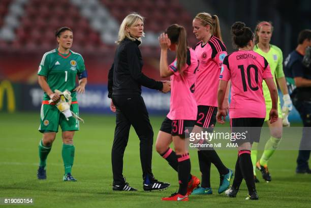 Anna Signeul manager / head coach of Scotland Women walks amongst her dejected players during the UEFA Women's Euro 2017 match between England and...