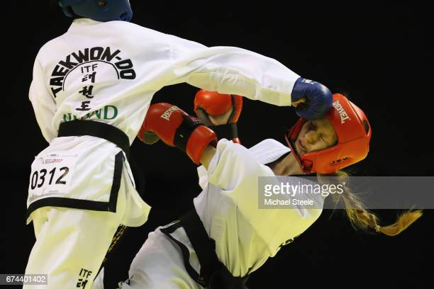 Anna Skuratova of Ukraine receives a blow from Sofia Hu of Ireland in the Individual Sparring Junior 1415 Female 52 kg category during day two of the...