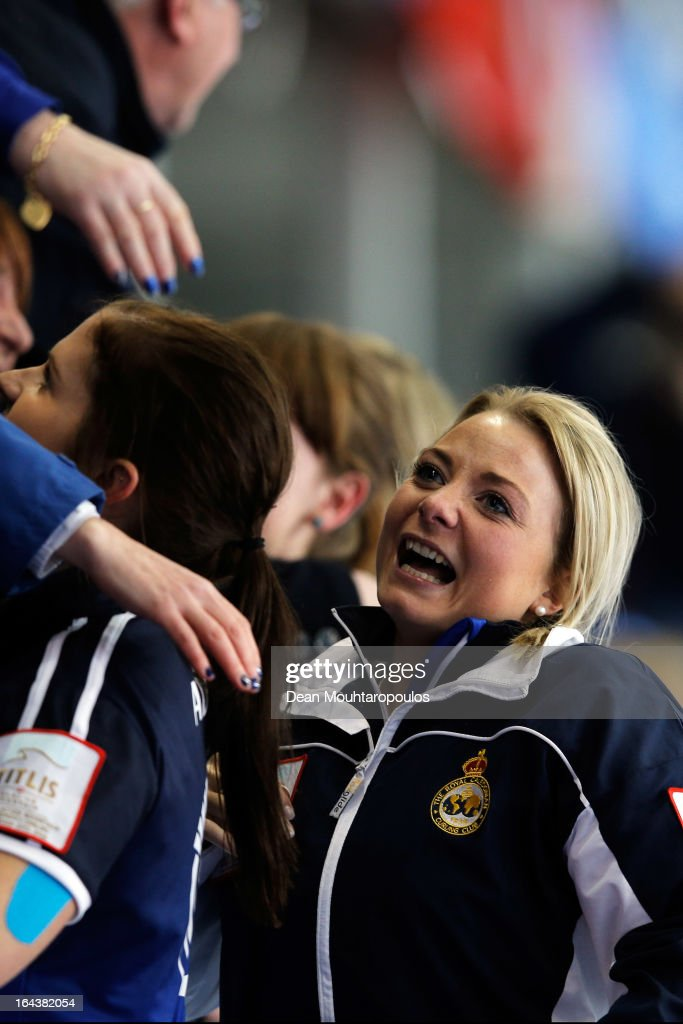 Anna Sloan of Scotland celebrates with fans after they win the Semi Final match between Scotland and Canada on Day 8 of the Titlis Glacier Mountain World Women's Curling Championship at the Volvo Sports Centre on March 23, 2013 in Riga, Latvia.