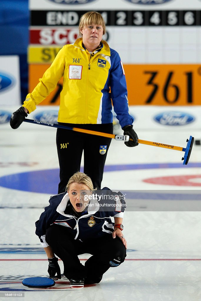 Anna Sloan of Scotland screams instructions as Maria Prytz of Sweden looks on during the Gold medal match between Scotland and Sweden on Day 9 of the Titlis Glacier Mountain World Women's Curling Championship at the Volvo Sports Centre on March 24, 2013 in Riga, Latvia.